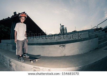 Happy boy with skateboard outdoors portrait.  - stock photo