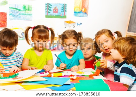 Happy boys and girls on creative lesson class - stock photo