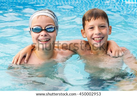 happy boys in the swimming pool