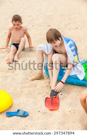 Happy boys playing on the beach  - stock photo