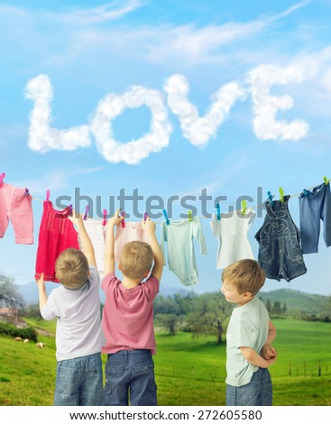 Happy boys waiting for siblings - stock photo
