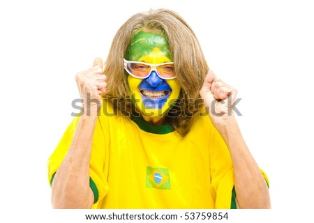 Happy Brazilian sport fan smile and nervous expression - stock photo