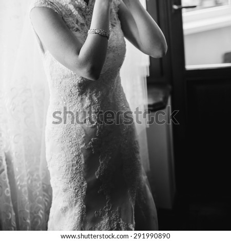 Happy bridal morning. Fiance getting ready. Wedding picture in black and white.