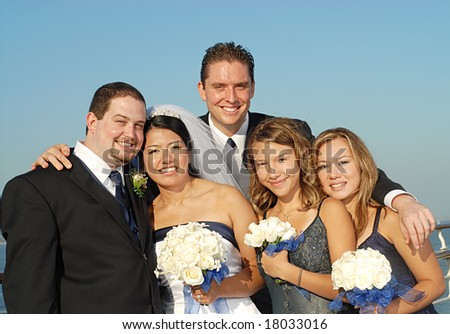 Happy bridal party outside during a wedding - stock photo