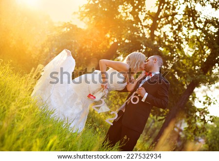 Happy bride and groom enjoying their wedding day in green nature