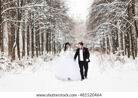 Happy bride and groom in winter wedding day