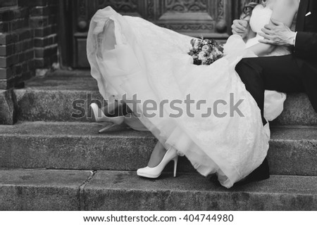 Happy bride and groom on steps of church in Copenhagen. Wedding couple together.  - stock photo