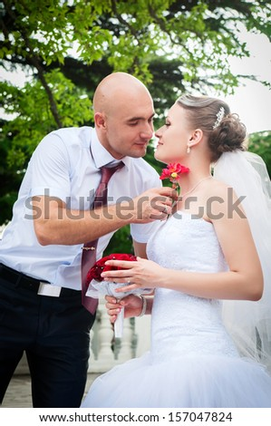 Happy bride and groom on wedding. newlywed couple at wedding day outdoors in park. man and woman at honeymoon. marriage. Loving couple embracing. Bride and groom on nature. Marriage. series
