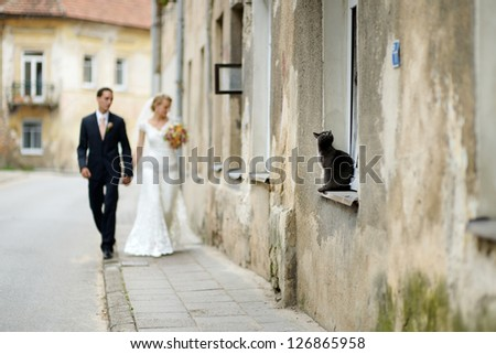 Happy bride and groom taking a walk together