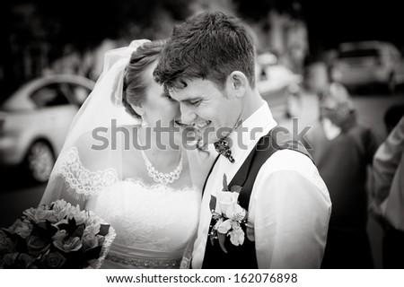 happy bride and groom talking to each other and lauhging - stock photo