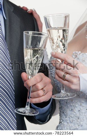 Happy bride and groom toasting with champagne - stock photo