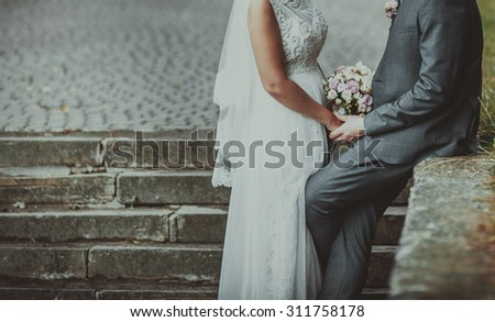 Happy bride and groom together. Summer wedding photo. - stock photo