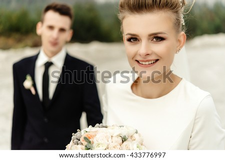 happy bride and stylish groom posing and smiling, luxury elegant wedding