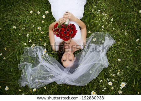 Happy bride enjoying her wedding day in nature - stock photo