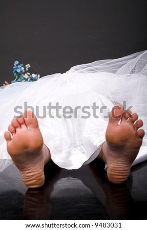happy bride lying on the black floor
