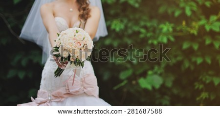 Happy bride outside. Wedding summer picture.  - stock photo