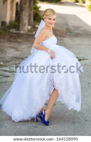 Happy bride posing in her wedding day - stock photo