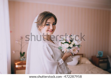 happy bride smiling at the camera