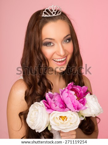 happy bride with a bouquet of peonies on a pink background - stock photo