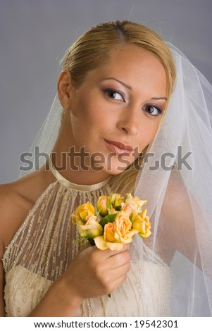 Happy bride with flowers in hands
