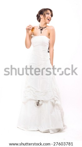 Happy bride with glass of champagne - stock photo