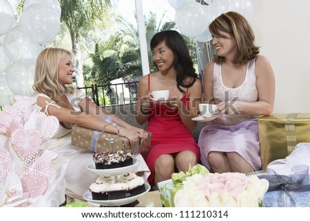 Happy bride with her friends at party