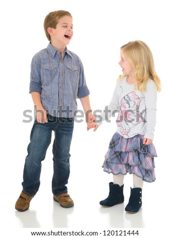 Happy Brother and Sister holding hands Laughing and playing - stock photo