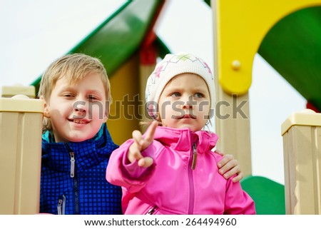 happy brother and sister on the playground  - stock photo