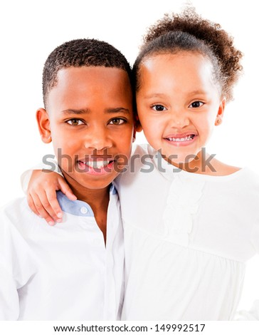 Happy brother and sister smiling - isolated over a white background