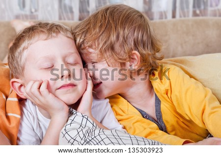 Happy brother and sister wake up in morning bed