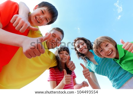 Happy brothers and sisters - stock photo