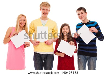 Happy brothers and sisters standing together with empty paper isolated over white background - stock photo