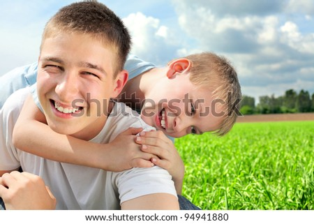 happy brothers in the summer field - stock photo