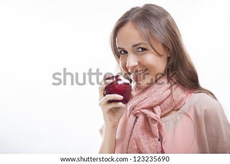 Happy brunette eating healthy - stock photo