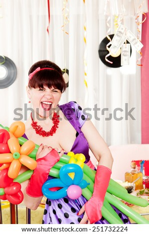 Happy brunette in retro style with bouquet of balloons - stock photo