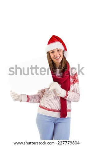 Happy brunette in winter clothes showing card on white background - stock photo