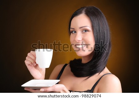 happy brunette with a cup of coffee - stock photo