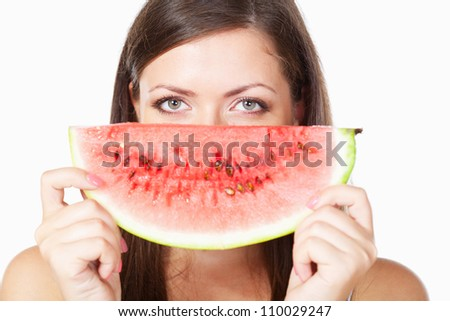 happy brunette woman behind watermelon over white
