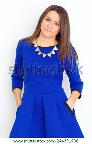 Happy Brunette Woman laughing. Beauty girl in a blue dress having fun