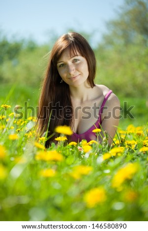 Happy  brunette woman relaxing in   park - stock photo