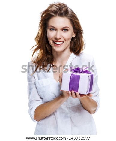Happy brunette woman with gift box. Photo of attractive brunette girl on white background