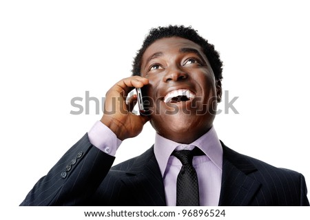 Happy business conversation african man laughing and chatting on the phone - stock photo