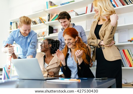 Happy business coworkers happy about company success and recent achievement - stock photo