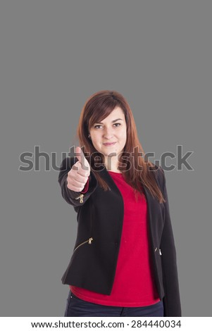 Happy business girl making OK with her finger - stock photo