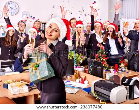 Happy business group people in santa hat at Xmas party. - stock photo