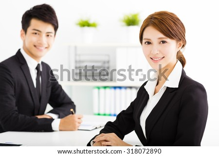 happy business man and woman working  in office - stock photo