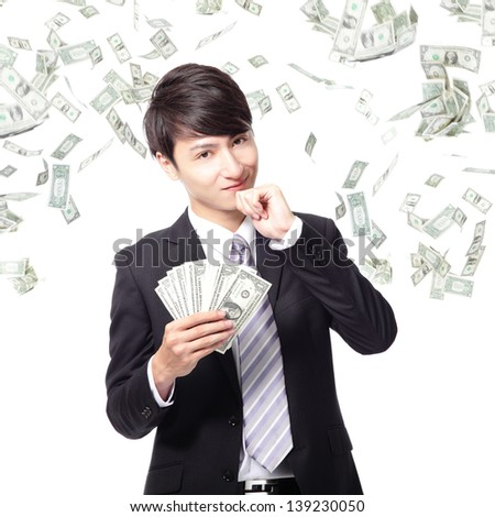 happy business man earned dollar bills us money under a money rain - isolated over a white background, asian model - stock photo