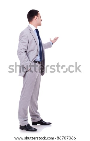 Happy business man giving presentation on white background - stock photo