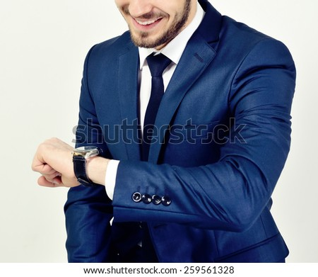 happy business man in suit with clock - stock photo