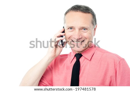 Happy business man making a call